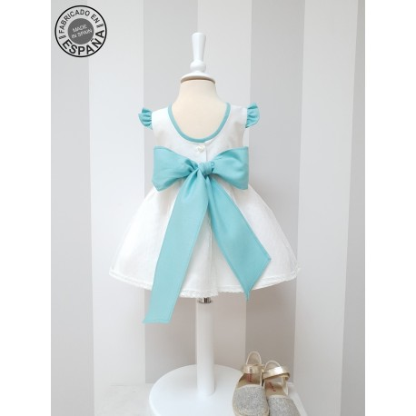 Ivory linen flower girl dress with turquoise details and sash. Soft polka dots tulle in skirt. Spanish style