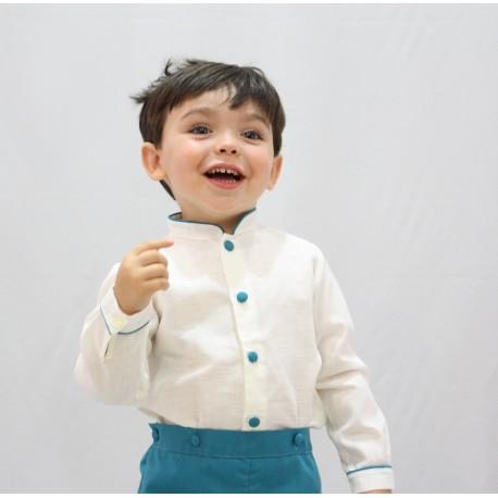 Traje de niño para boda. Lino crudo con pantalón azul mar