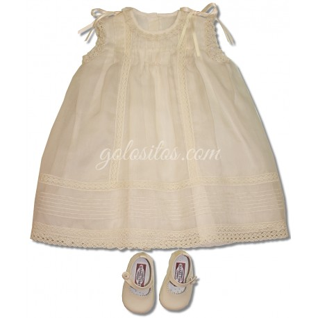 Christening gown, in ivory silk organza and ivory cotton laces.